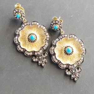 Gold and turquoise dangle earrings.